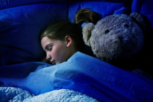 Sleeping girl with teddy bear